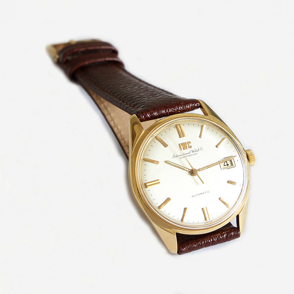 a vintage international watch company mens watch with gold case dated 1968