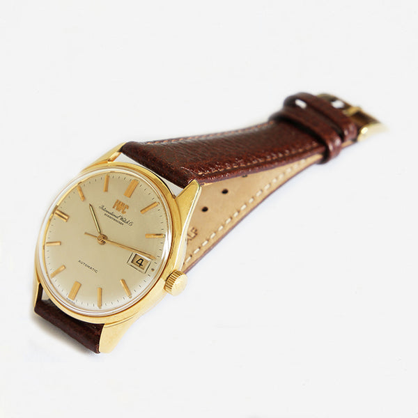 a secondhand excellent vintage 1960s mens IWC watch with yellow gold case and leather strap