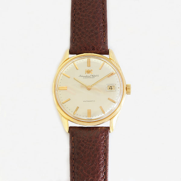 a vintage international watch company mens watch with gold case and leather strap