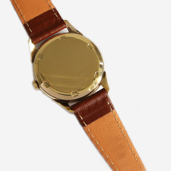 a preowned vintage garrard watch with gold case