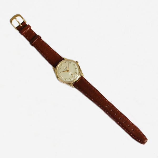a secondhand garrard gents watch with gold case and leather strap with box