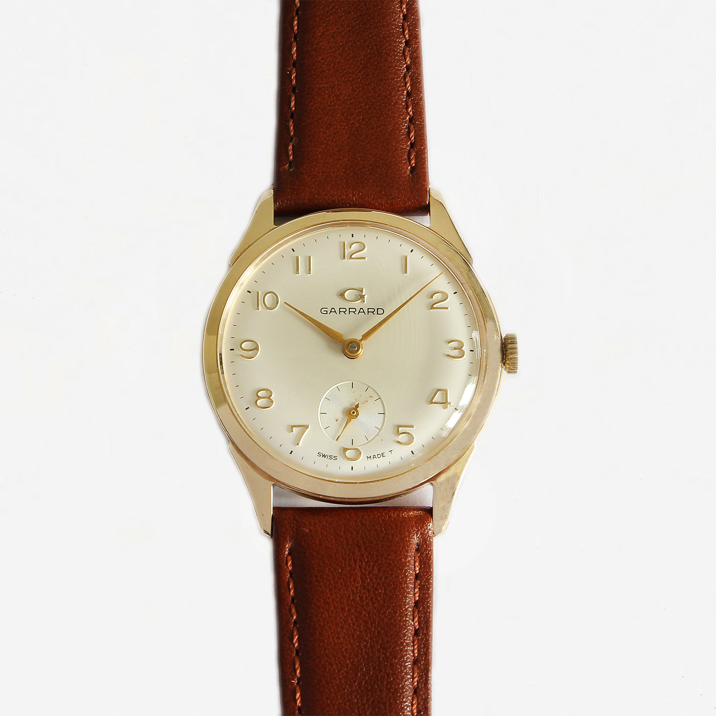 a garrard secondhand vintage watch with gold case and leather strap