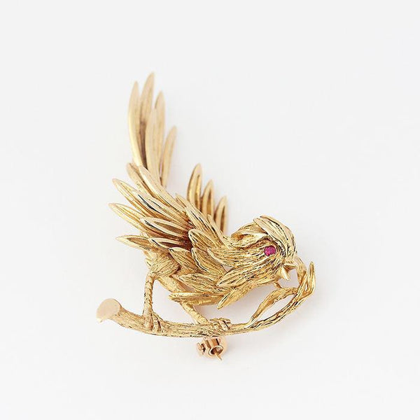 an 18ct yellow gold secondhand boucheron bird brooch with a ruby set eye