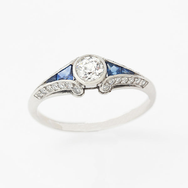 an art deco ring in platinum with sapphires and diamonds in a cluster design