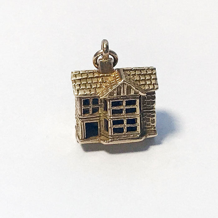 a stunning yellow gold dolls house charm with enamel rooms inside