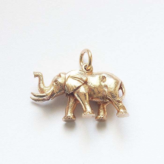 a fine quality walking elephant gold charm
