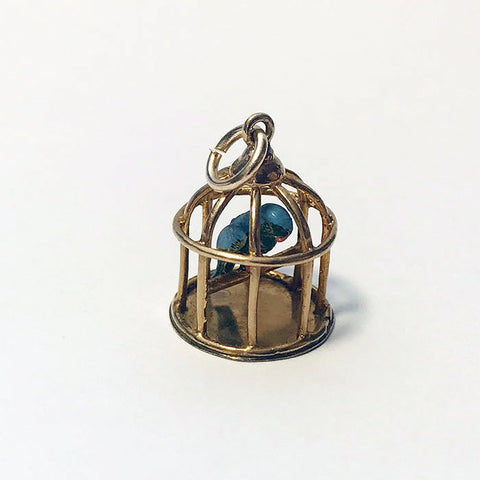 a wonderful enamel parrot in a cage gold charm