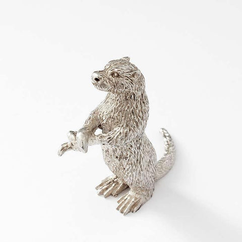 a fine quality large sterling silver otter ornament model holding an eel with a full british hallmark