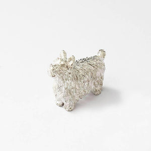 a sterling silver yorkshire terrier dog figure with textured fur and a full british hallmark