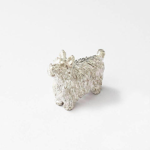 a sterling silver yorkshire terrier dog ornament with textured fur and a full british hallmark