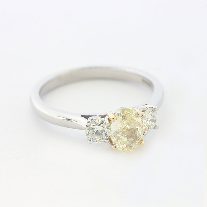 diamond 3 stone ring with central yellow diamond all in platinum