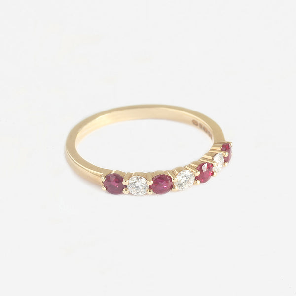 a new ruby and diamond ring in yellow gold with claw settings