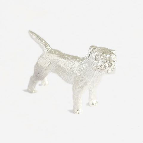 a sterling silver border terrier dog figure