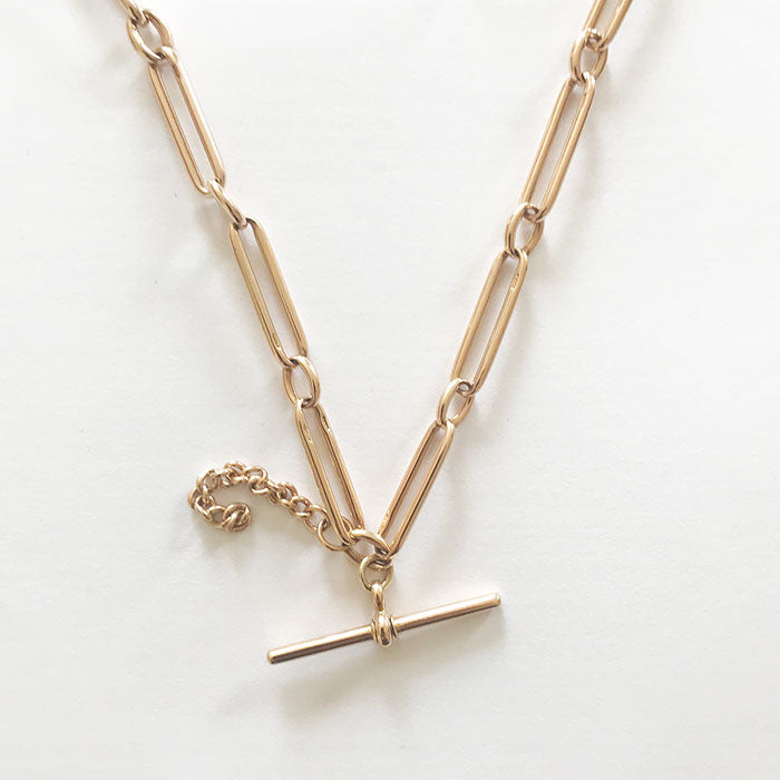 a heavy solid rose gold antique Albert chain with full hallmark on each link