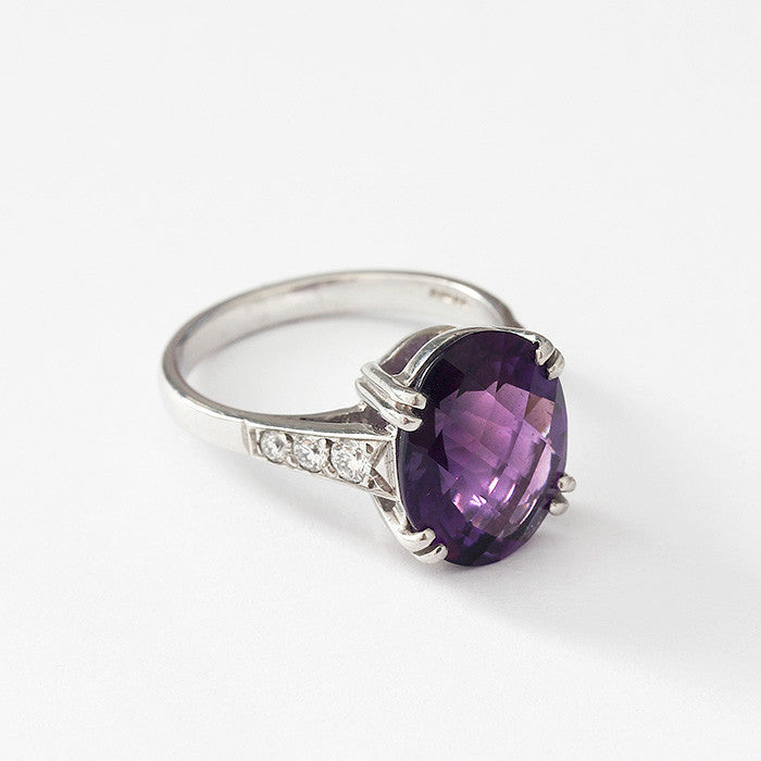 large amethyst and diamond ring with claw setting and white gold band