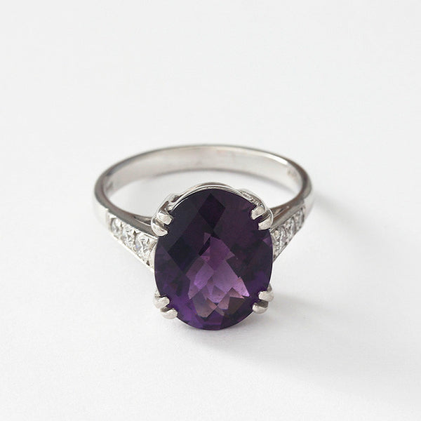 an amethyst and diamond ring in white gold size M 1/2