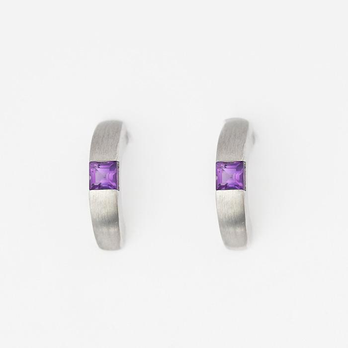 amethyst stone set in a half hoop earring made in sterling silver