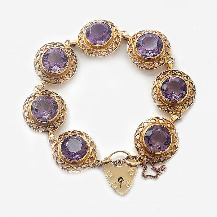 a stunning amethyst patterned circular bracelet in yellow gold with padlock