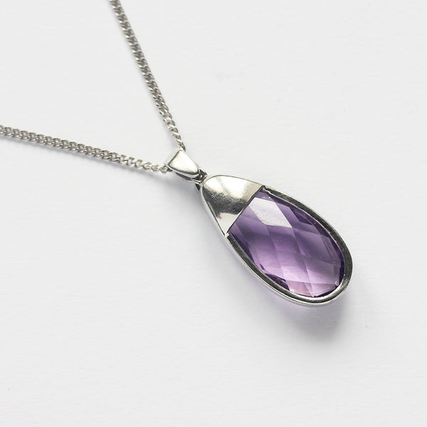 an amethyst and diamond set pendant necklace in white gold at marston Barrett in lewes sussex