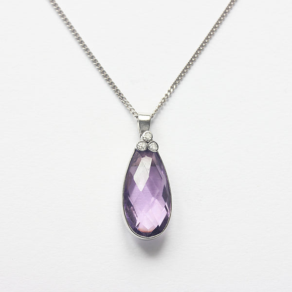 a beautiful amethyst and diamond pendant in white gold with a curb link necklace