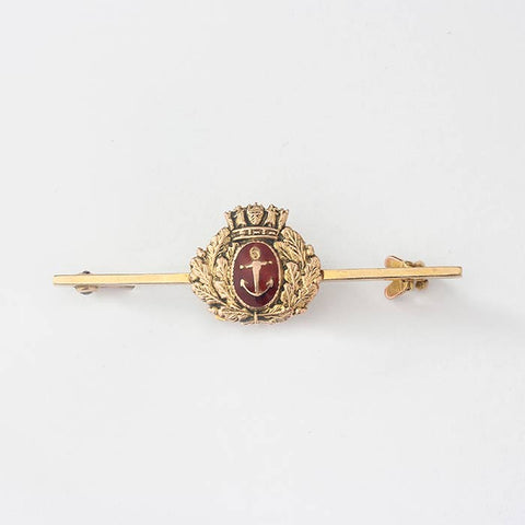 a crown and wreath naval gold bar brooch with red enamel motif and stamped 375 for 9 carat gold