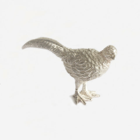 a female silver pheasant figure standing up looking to one side
