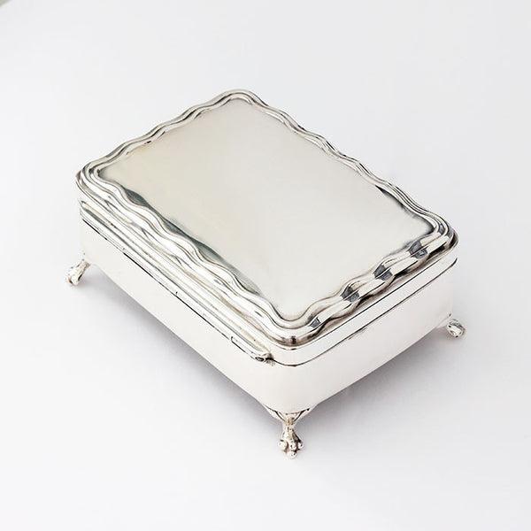 silver miniature trinket box with green velvet inside rectangle shape with 4 feet