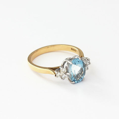 aquamarine and diamond 7 stone ring in 18ct gold claw setting
