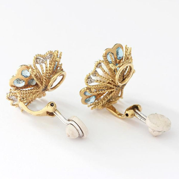 a vintage floral shaped pair of clip earrings with a central pearl and aquamarines and diamonds