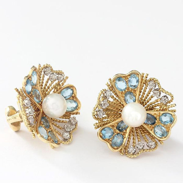 a secondhand pair of earrings in yellow gold ornate floral shape with central pearl aquamarine and diamonds