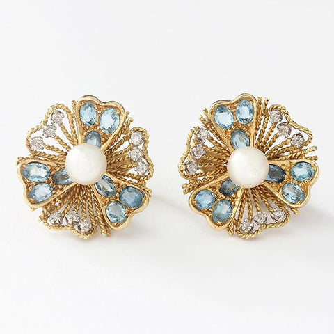 secondhand flower clip on earrings in yellow gold with a central pearl and 9 aquamarine stones and 9 small diamonds
