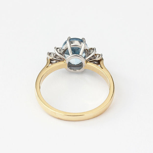 gold diamond and aquamarine 7 stone ring in a claw setting