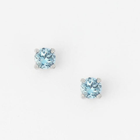 a single faceted aquamarine 4 claw pair of earrings in white gold setting and yellow gold post