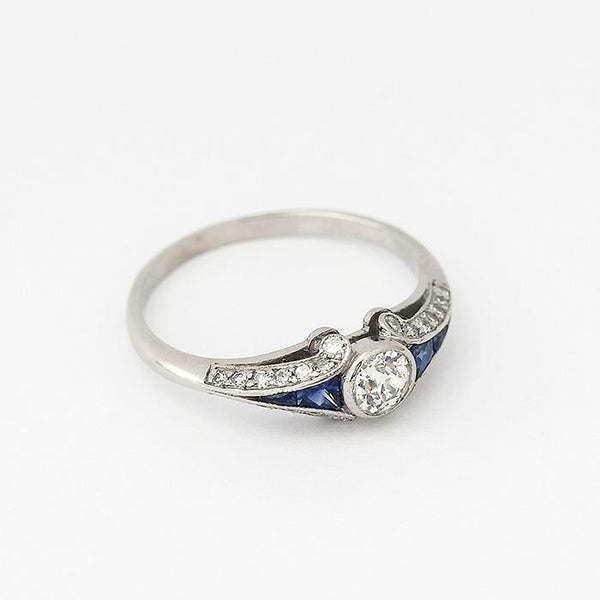 an art deco sapphire and diamond set ring in white metal