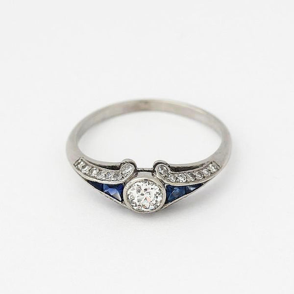 a sapphire and diamond cluster art deco ring in platinum