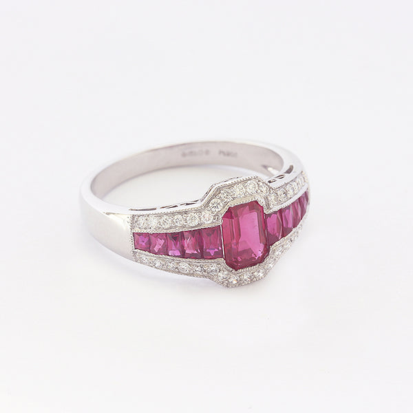 a beautiful modern ruby and diamond cluster ring in platinum