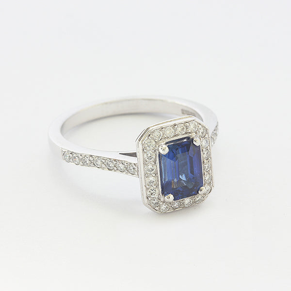 a sapphire and diamond rectangular cluster ring in white gold