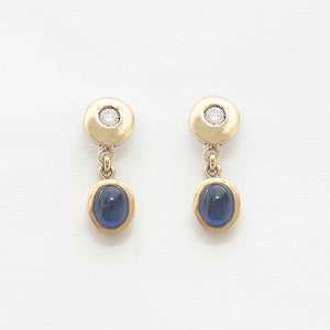 a cabochon sapphire and diamond drop pair of earrings in yellow gold