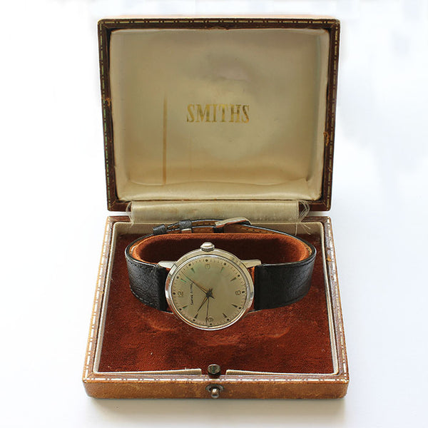 a vintage preowned smiths astral mens watch with stainless steel case and black leather strap and original box