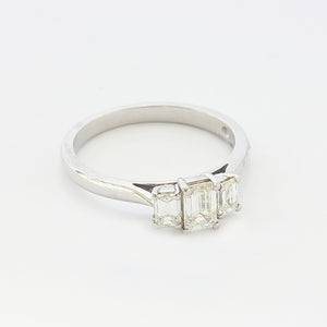 a platinum diamond set 3 stone ring with a claw setting