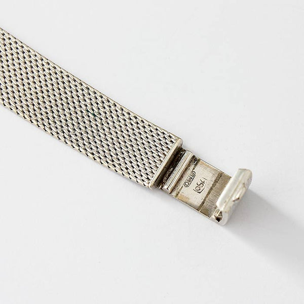 a ladies baume and mercier wrist watch in 18 carat white gold case and bracelet with diamond edges hallmarked