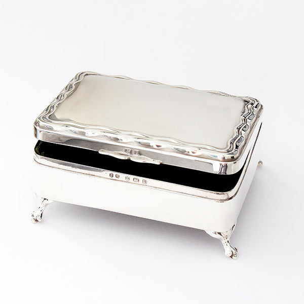 silver jewellery box with green velvet interior and hallmarked 1910