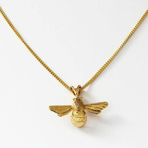 a bee pendant with curb link chain all made in 9 carat yellow gold with sapphire set eyes