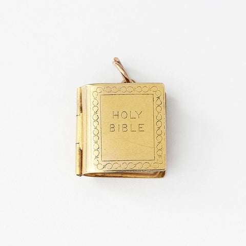 the holy bible charm in 9ct yellow gold and opens with paper prayer inside