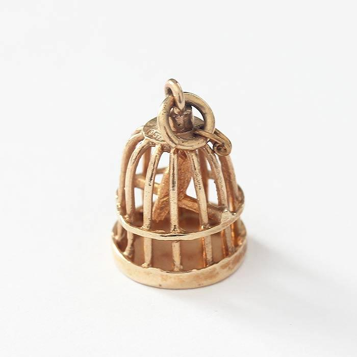 a vintage bird cage yellow gold charm