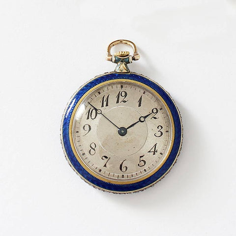 an antique ladies fob watch with blue enamel and diamond set floral pattern