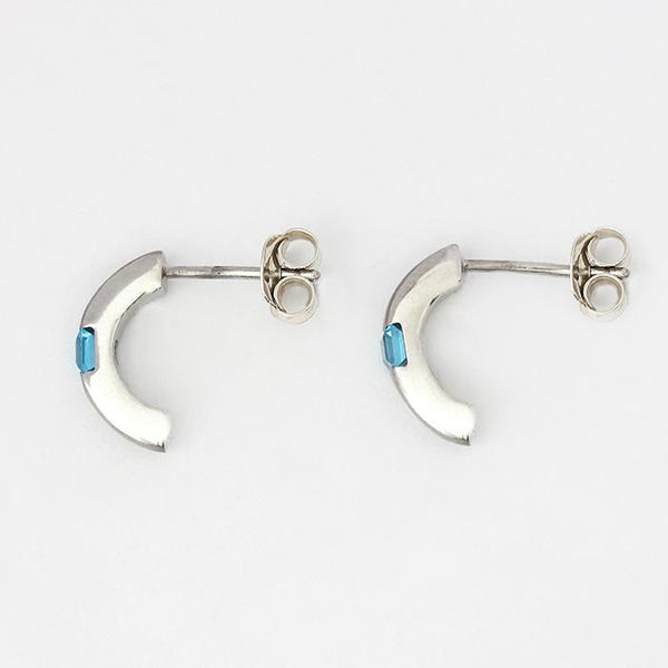 silver half hoop earrings with a square blue topaz stone and satin brushed finished half hoop