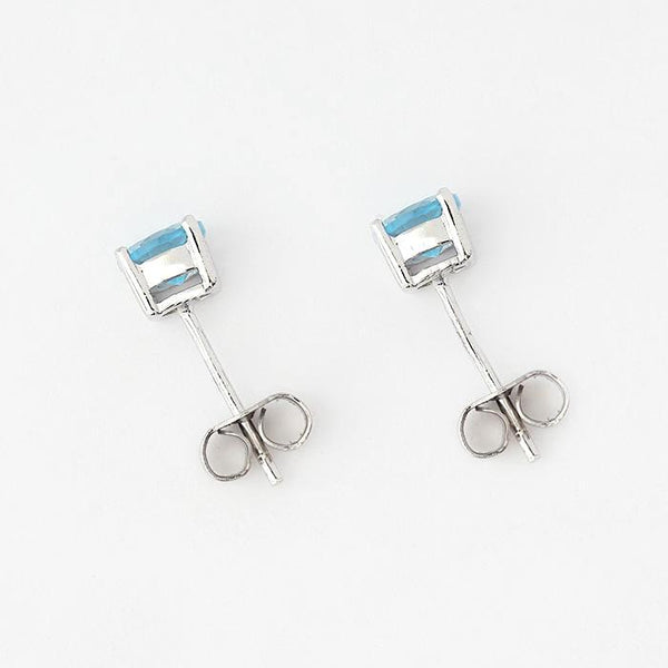 silver round blue topaz stud earrings in 5mm diameter and 4 claws