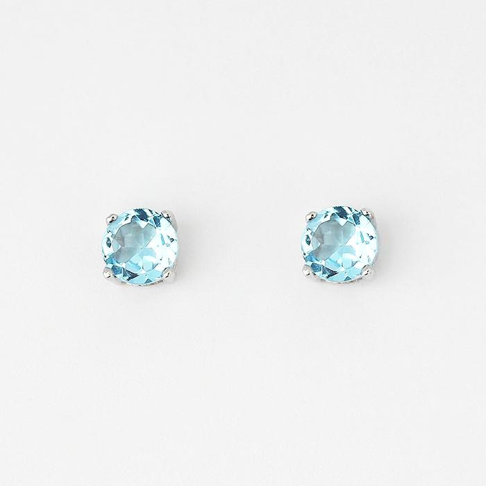blue topaz round stud earrings with 4 claw settings and set in silver