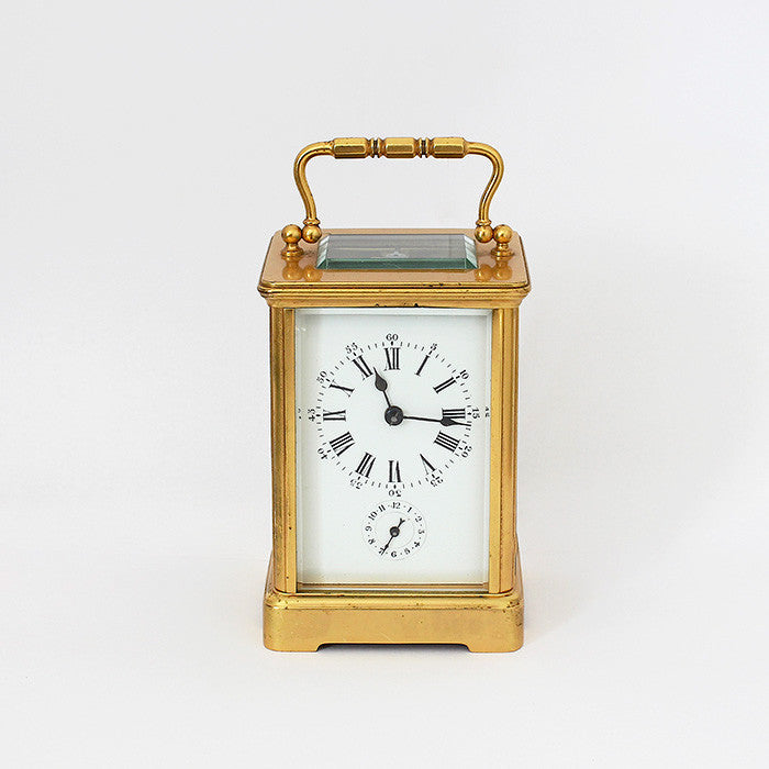 a brass antique french carriage clock with 8 day movement
